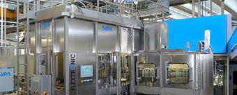 Synchronized blowing and filling for edible oil bottles